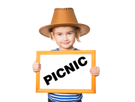 picknick: Little Funny girl in striped shirt with blackboard. Text PICNIC. Isolated on white background. Stock Photo