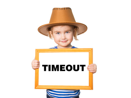 Little Funny girl in striped shirt with blackboard. Text TIMEOUT. Isolated on white background. Stockfoto