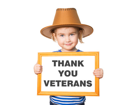 Little Funny girl in striped shirt with blackboard. Text THANK YOU VETERANS. Isolated on white background. Stockfoto