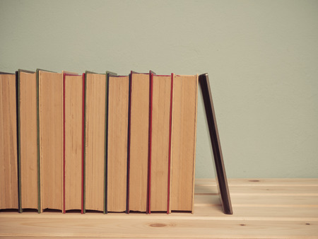e waste: Books on a wooden shelf on a blue background Stock Photo