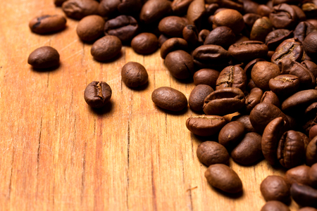 coffeetree: Coffee beans on wood background. Coffee on grunge wooden background Stock Photo