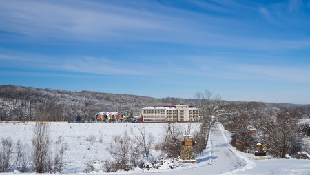 snow road: Winter view of the hotel in the mountains. Snow road.
