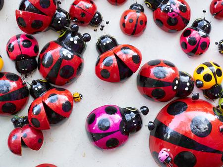 septempunctata: Lots of colorful wooden ladybugs. Toys, magnets. Stock Photo