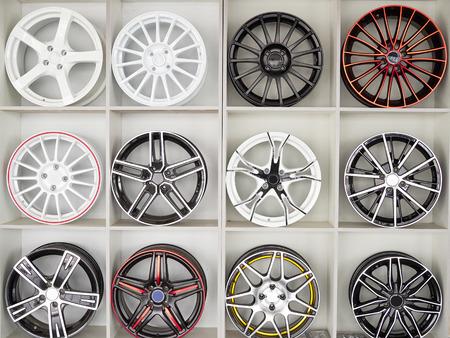 disks: Set of car wheel disks, on shelf.
