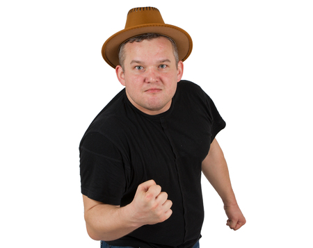 gangster background: Gangster in  hat angry man holding fists against.  Isolated white background