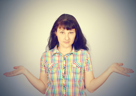 no idea: woman showing astonishment isolated on gray background. No idea concept Stock Photo