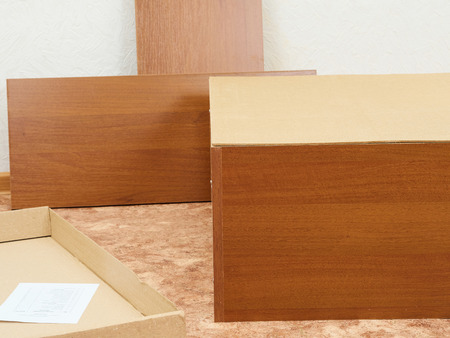 cabinets: New unassembled cabinets. Furniture for Assembly. Stock Photo