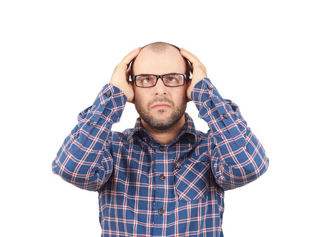 neurosis: Man with glasses holding his head with his hands. Stress, neurosis, disorder .Isolated on a white background.
