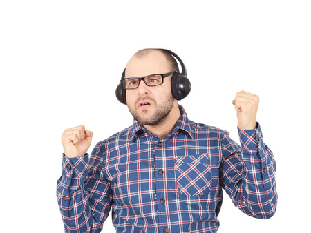 sings: Men in headphones listens to music and sings. Isolated on a white background.