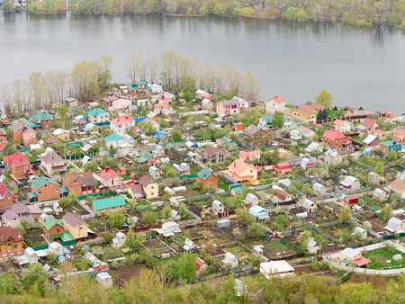 strongly: River Flood Aerial View  Homes and Park. Aerial view of the residential area of the suburb