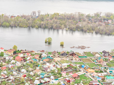 flood area: River Flood Aerial View  Homes and Park. Aerial view of the residential area of the suburb