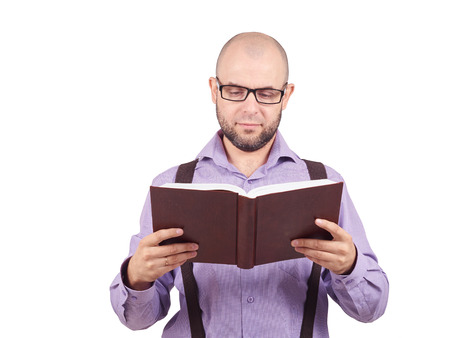 lecturing: man caucasian professor in a lavender shirt with a beard reading old book isolated studio on white background