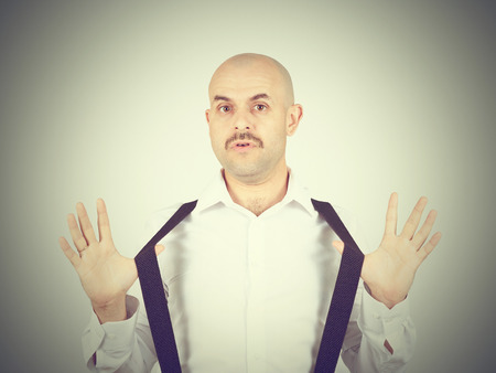 bald man shrugging shoulders I dont know gesture Isolated.  Human body language. Stock Photo