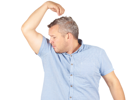unbearable: Fat man, smelling sniffing his armpit, something stinks bad, foul odor Isolated on white background.