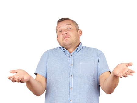 i dont know: Fat man shrugging shoulders I dont know gesture Isolated on white background.. Human body language. Stock Photo