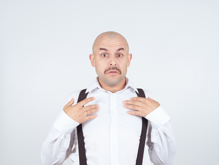 causal: bald man shrugging shoulders I dont know gesture Isolated.  Human body language. Stock Photo