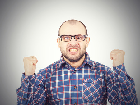 bad temper: Angry bald man in glasses.  Isolated on a white background. Stock Photo