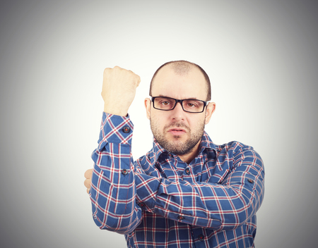 menacing: Man fist raised menacing threat. emotions and people concept. isolated on white background. Stock Photo