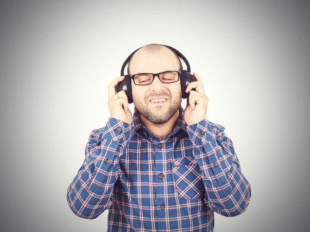 canister: Men in headphones listens to music and sings. Isolated on a white background.
