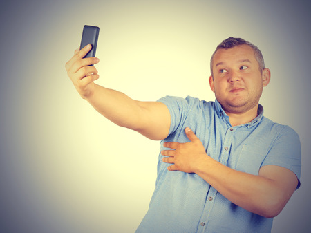 Funny picture of  plump man on background. businessman doing selfie. Stock Photo