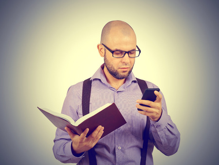lecturing: man caucasian professor in a lavender shirt with a beard reading old book isolated studio background