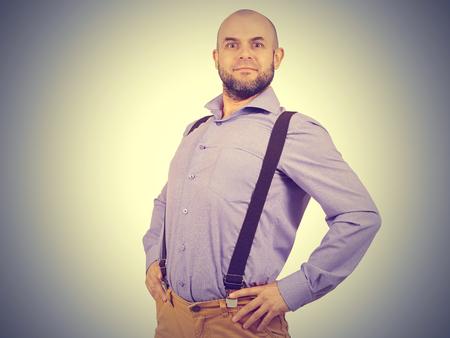 Happy funny arrogant bald man with a beard.