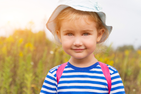 shool: Cute girl in hat smiling in the Park closeup Stock Photo