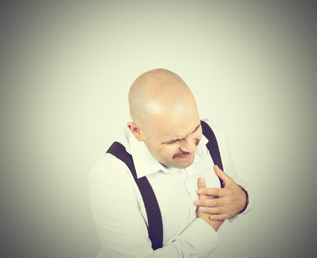 Male heart pain. The bald man with a mustache. Cardio. Heart attack.