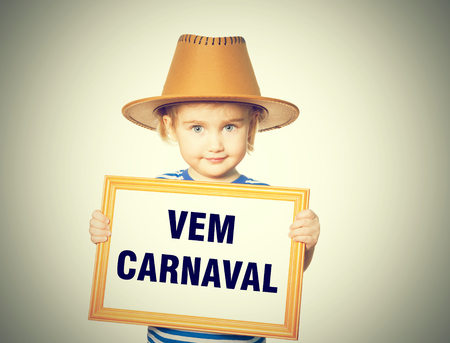 carnaval: Little Funny girl in striped shirt with blackboard. Text  vem carnaval.  Isolated on white background.