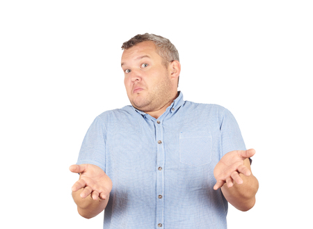 i don't know: Fat man shrugging shoulders I dont know gesture Isolated on white background.. Human body language. Stock Photo