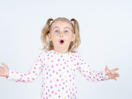 arms out: Little girl arms out surprise. Emotions. Stock Photo