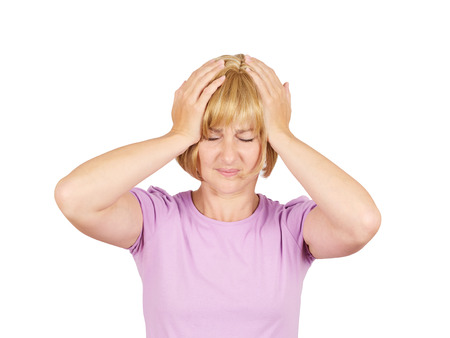 ocd: Woman suffering from headache. Blonde girl remembered something and holding his head. Isolated on background.