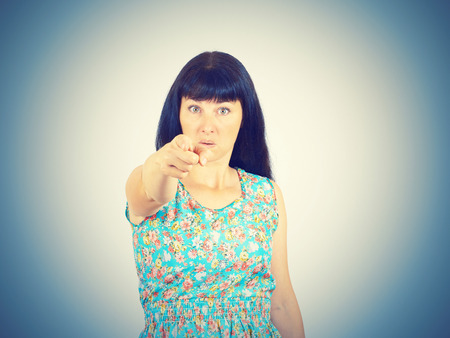 Young woman accusing someone  pointing with finger  Stock Photo