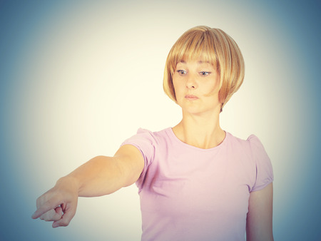 Angry young woman pointing finger. isolated on  background.