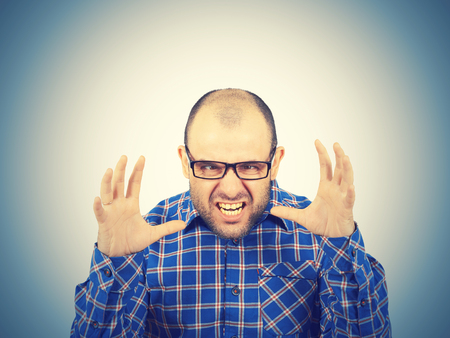 Angry bald man in glasses.  Isolated on a white background. Stock Photo