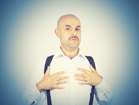 uninterested: bald man shrugging shoulders I dont know gesture Isolated.  Human body language.