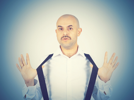 i don't know: bald man shrugging shoulders I dont know gesture Isolated.  Human body language.