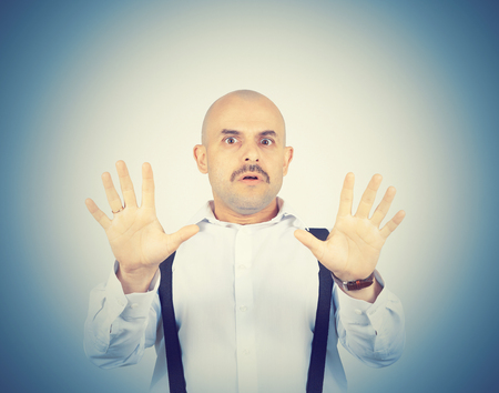 awkward: bald man feels awkward, anxiously isolated. fear phobia Stock Photo
