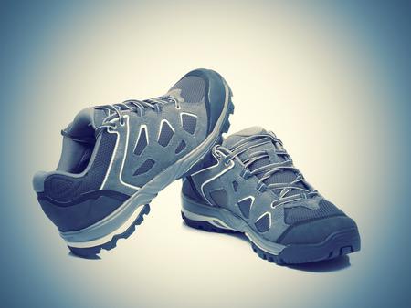 적합: Walking trekking shoes isolated on the white backgroun