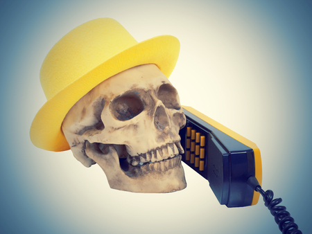 Skull in yellow hat on phone  isolated on white background.