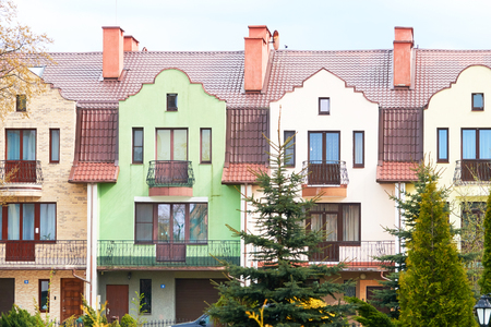 Colorful houses facades, pastel pale colors in Europe.                             Stock Photo