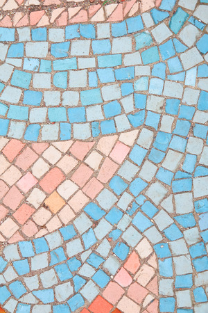 Beautiful background of multi-colored tiles. Tiled mosaic in pastel colors. Blue, red, pink