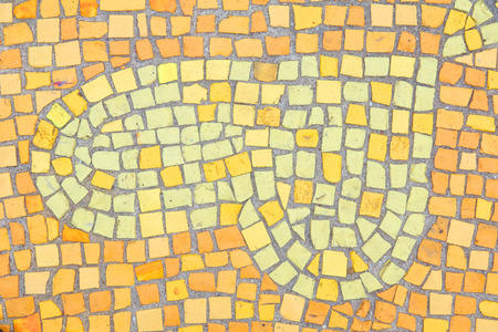 Beautiful background of multi-colored tiles. Tiled mosaic in pastel colors in the form of a heart. Brown, yellow, orange
