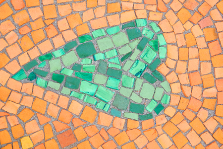 Beautiful background of multi-colored tiles. Tiled mosaic in pastel colors in the form of a heart. Green, yellow, orange