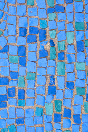 Beautiful background of multi-colored tiles. Tiled mosaic in pastel colors. blue, green