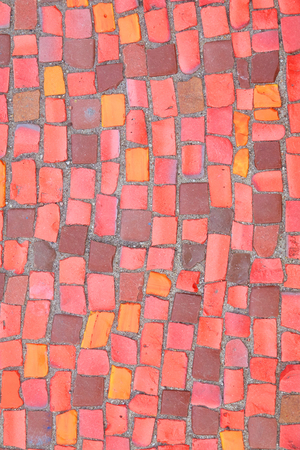 Beautiful background of multi-colored tiles. Tiled mosaic in pastel colors.Red, pink, yellow