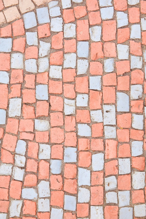 Beautiful background of multi-colored tiles. Tiled mosaic in pastel colors.Red, pink, blue, gray