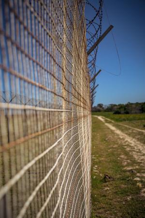 Fenceline on Robben Island Stock Photo