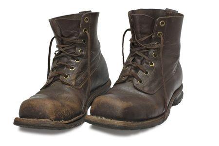 zwei alten brown, Stiefel, die isoliert auf wei�