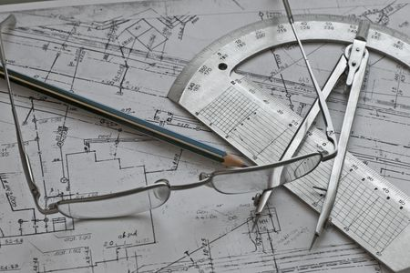 geodesy concept with calliper, pensil, glass,protractor and scheme Stock Photo